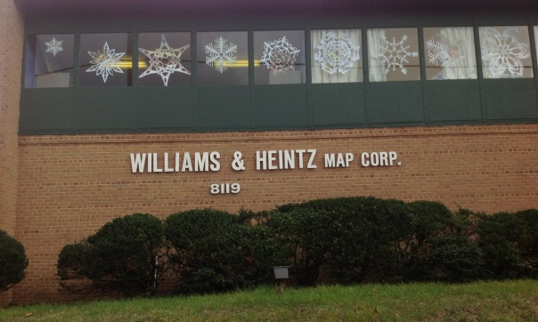 Williams & Heintz Map Corp. is decorated for the season with giant paper snowflakes made of maps.