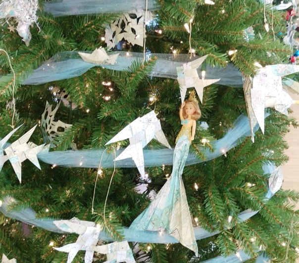 Paper boats, mermaids, fish, and snowflakes on the Williams & Heintz Corp tree for Calvert Hospice Festival of Trees